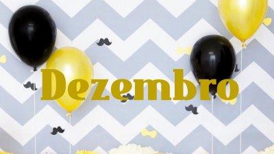 Balões de festa pretos e amarelos com Dezembro escrito no centro da imagem