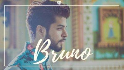 Bruno escrito sobre foto de homem de barba sério olhando para o lado