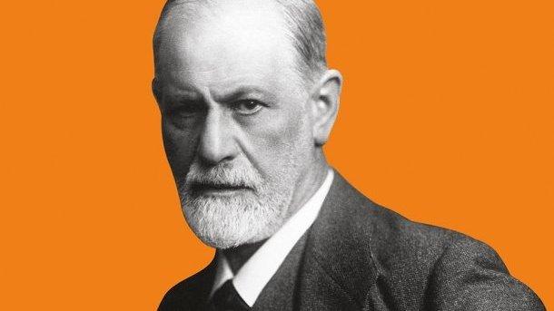 Foto do psicólogo Sigmund Freud sobre fundo laranja.