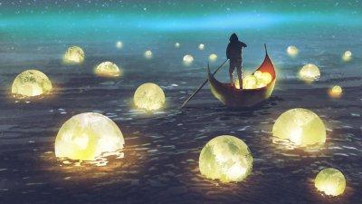 Pessoa remando em oceano de luas