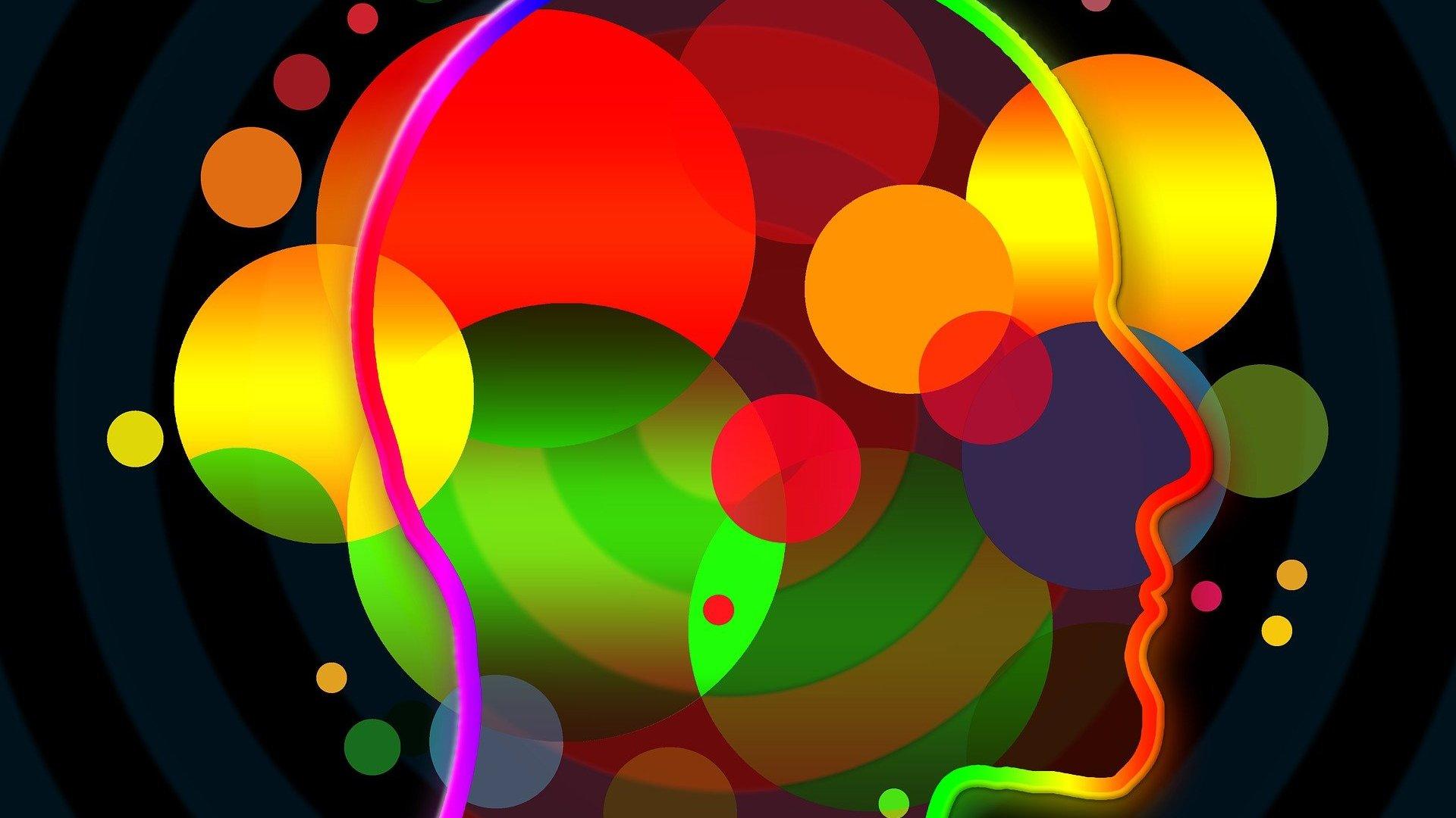 Ilustração gráfica de silhueta de cabeça preenchida por diversas formas coloridas
