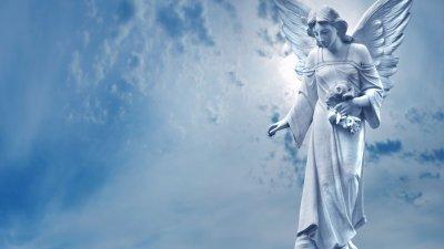 Imagem de escultura de anjo da guarda.